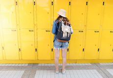 Woman traveler using the locker service and go vacation in the city stock photography