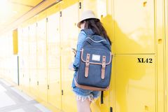 Woman traveler using the locker service and go vacation in the city royalty free stock photos