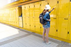 Woman traveler using the locker service and go vacation in the city stock image
