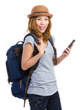 Woman traveler using mobile phone for information Stock Photo