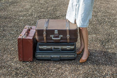 Woman traveler with vintage luggage Stock Images