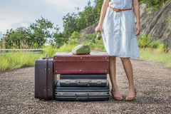 Woman traveler with vintage luggage Stock Photos