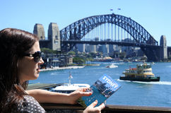 Woman traveler visit in Sydney Australia. Woman traveler visit in Sydney New South Wales, Australia. Holding a travel brochure with photo cover of a photo taken stock photo