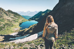 Woman traveler walking at lake in mountains. Travel Lifestyle adventure concept summer vacations outdoor exploring landscapes Stock Photo