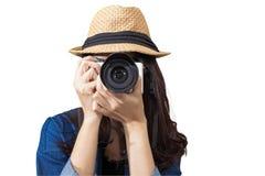 Woman traveler wearing blue dress as photographer, take photo wi Stock Photo