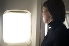 Woman traveling by air Stock Photos
