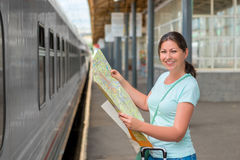 Woman traveling alone keeps the card Stock Images