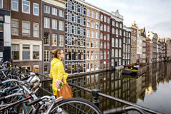Woman traveling in Amsterdam Stock Images