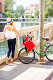 Woman traveling with bicycle in Ljubljana city Stock Image