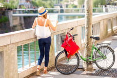 Woman traveling with bicycle in Ljubljana city Royalty Free Stock Images