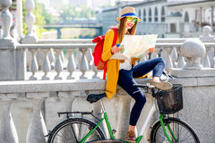 Woman traveling with bicycle in Ljubljana city Royalty Free Stock Photo