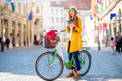 Woman traveling with bicycle in Ljubljana city Stock Photo