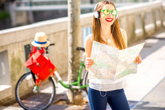 Woman traveling with bicycle in Ljubljana city Stock Images