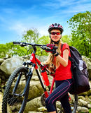 Woman traveling bicycle summer park. Early morning with sun rays. Royalty Free Stock Image