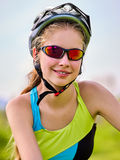 Woman traveling bicycle summer park. Early morning with sun rays. Stock Photo