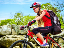 Woman traveling bicycle summer park. Early morning with sun rays. Royalty Free Stock Photos