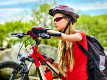 Woman traveling bicycle summer park. Early morning with sun rays. Stock Photos