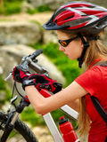 Woman traveling bicycle summer park. Girl with smart watch traveling. Woman on bicycle ride mountain. Girl with smart watch traveling in summer park. Cycling Stock Photography