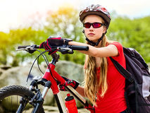 Woman traveling bicycle summer park. Girl with smart watch traveling. Woman on bicycle ride mountain. Girl with smart watch traveling in summer park. Cycling Stock Images