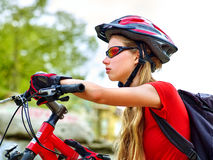 Woman traveling bicycle summer park. Girl with smart watch traveling. Woman on bicycle ride mountain. Girl with smart watch traveling in summer park. Cycling Royalty Free Stock Photos