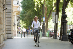 Woman traveling by bike in the city Stock Photography