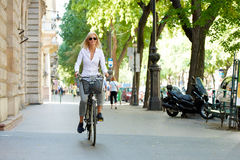 Woman traveling by bike in the city Stock Image