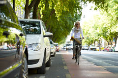 Woman traveling by bike in the city Stock Photos