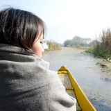 Woman traveling by boat Stock Images
