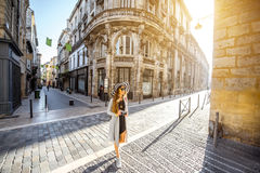 Woman traveling in Bordeaux city. Young woman tourist walking on the street during the morning in Bordeaux city in France stock images