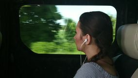 Woman traveling by bus and looking out the window stock footage