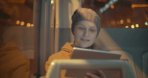 Woman traveling by bus with touch pad stock footage