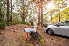 Woman Traveling by car in the forest Stock Image