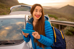 Woman traveling by car on the mountain road Stock Photography