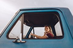 Woman traveling by a car on road trip stock photos