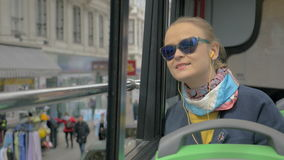 Woman traveling in city by double-decker bus stock video footage