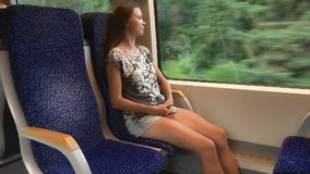 Woman traveling by a comfortable fast train stock video footage
