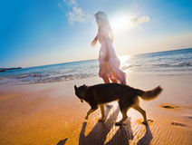 Woman traveling with dog Stock Photography