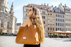 Woman traveling in Dresden city, Germany. Businesswoman walking with bag at the old city center of Dresden, Germany royalty free stock photos