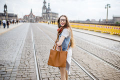 Woman traveling in Dresden city, Germany. Lifestyle portrait of a business woman walking the bridge in the old town of Dresden, Germany royalty free stock photo