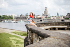 Woman traveling in Dresden city, Germany. Lifestyle portrait of a stylish woman on the bridge traveling in Dresden city, Germany royalty free stock photo