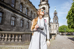 Woman traveling in Dresden city, Germany. Lifestyle portrait of a woman tourist walking on the Bruhl terrace in Dresden, Germany royalty free stock images