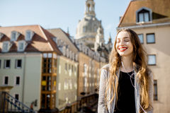 Woman traveling in Dresden city, Germany. Portrait of a young beautiful woman sitting on the famous Bruhl terrace with great view on the old town in Dresden royalty free stock photography