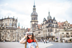 Woman traveling in Dresden city, Germany. Young woman with photocamera walking on the Theaterplatz in Dresden, Germany royalty free stock photo