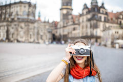 Woman traveling in Dresden city, Germany. Young woman with photocamera walking on the Theaterplatz in Dresden, Germany stock photo