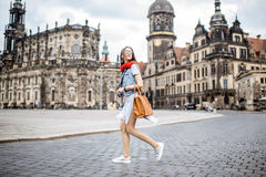 Woman traveling in Dresden city, Germany. Young woman with photocamera walking on the Theaterplatz in Dresden, Germany stock images
