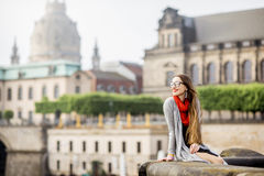 Woman traveling in Dresden city, Germany. Young woman tourist with photo camera enjoying great view from the bridge on the old town of Dresden in Germany stock images