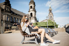 Woman traveling in Dresden city, Germany. Young woman tourist sitting on the bench on the Bruhl terrace in Dresden, Germany royalty free stock photography