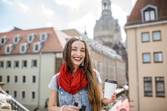 Woman traveling in Dresden city, Germany. Young woman tourist sitting with coffee cup on the famous Bruhl terrace with great view on the old town in Dresden stock photography