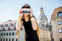 Woman traveling in Dresden city, Germany. Young woman tourist standing with photo camera on the famous Bruhl terrace with great view on the old town in Dresden stock photography