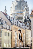 Woman traveling in Dresden city, Germany. Young woman tourist walking on the famous Bruhl terrace with great view on the old town in Dresden, Germany stock images